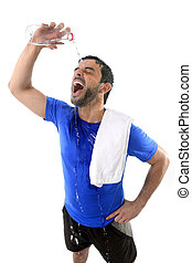 young attractive and athletic sport man exhausted pouring...