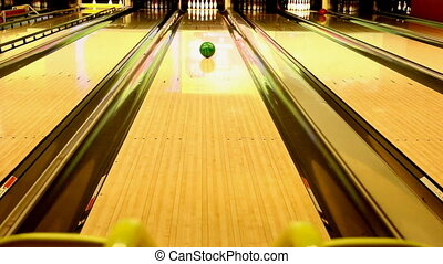 Bowling ramp - Ball rolling down the lane toward ten pins...