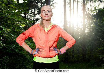 Running - Young lady running on a forest road
