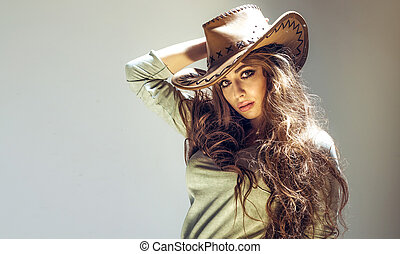 Attractive brunette beauty - Beautiful brunette cowgirl...