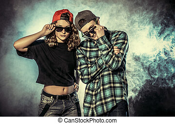 urban style - Two modern dancers over grunge background...