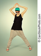 freestyle - Modern girl dancer dancing in hip-hop style...