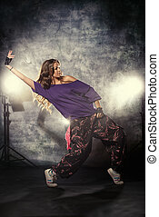 discogirls - Modern hip-hop dancer over grunge background