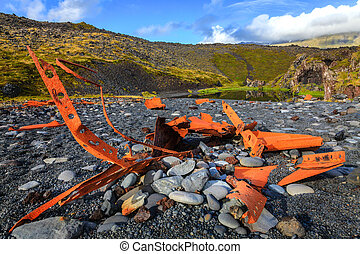 Shipwreck - Forty years-old shipwreck on a beach on...
