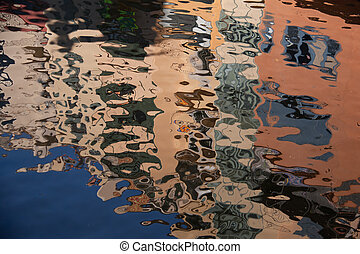 Isolated close-up of ripples on surface reflection of...