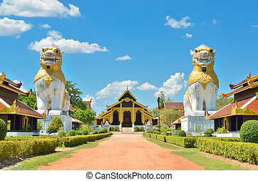 two lions with ancient building at Surasri Camp,...