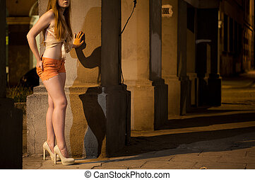 Prostitute working on the street at night