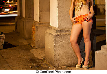 Prostitute waiting for client on the street