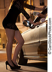 Man paying prostitute - Man in car paying prostitute for her...