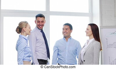 business team doing high five gesture in office - business,...
