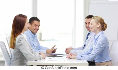 smiling team with table pc working in office - business,...