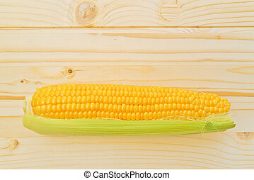 Corn Cob on wooden table - Fully developed Corn Cob with...