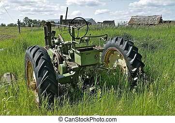 Old tractor on deserted farm