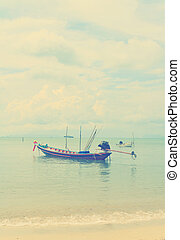 Long Tail Boat in Clear Water and Blue sky with retro filter...