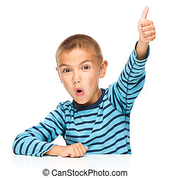 Little boy is showing thumb up sign