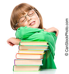 Little girl is sleeping on her books