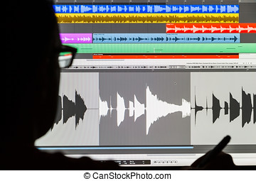Man Editing Digital Audio on a Computer - Silhouette of a...