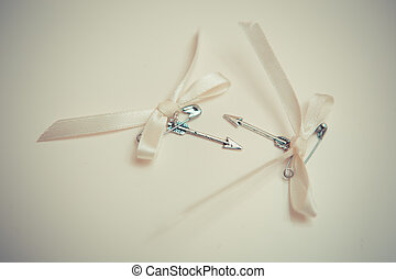Silver arrows of love with bows. wedding decoration