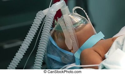 unidentified child with oxygen mask ready for surgery