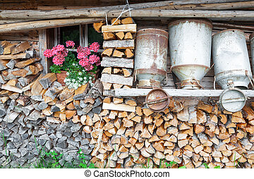 old milk cans and firewood - decorative old milk cans of a...