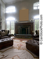large living room with leather chairs and fireplace