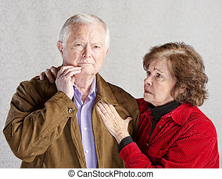 Worried Elderly Couple - Worried wife holding concerned...