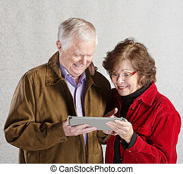 Excited Couple with Tablet
