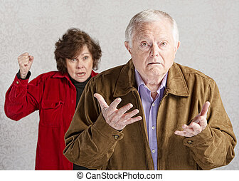 Confused Senior Male - Confused elderly man with angry older...