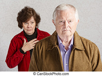 Worried Wife - Concerned senior woman with hand on chest...