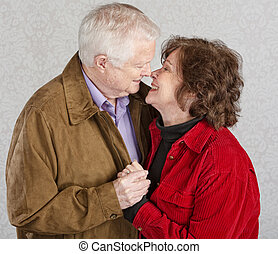 Cute Kissing Couple - Loving older man and woman kissing...