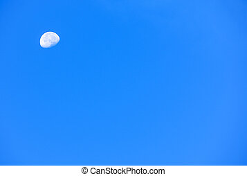 half moon and light blue sky in early morning