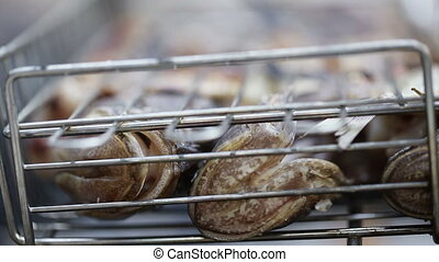 Saltwater fish on grill - Freshly caught sea fish cooked on...