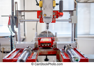 close-up of industrial metal drilling machinery. factory tools