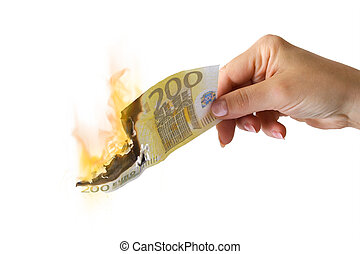 Economy crisis - A euro banknote burn in the woman hand