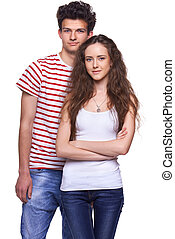 Young casual couple - Beautiful young couple standing over...
