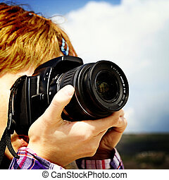 PHotographer - Young photographer making pictures in nature