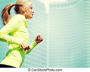 woman doing running outdoors - sport and lifestyle concept -...