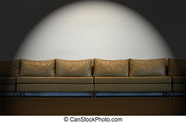 couch on white wall with lights