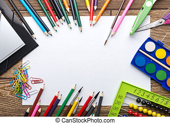 School stationery frame on wooden background: paper, pencil,...