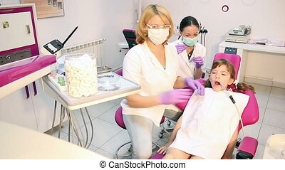 dentist nurse and little girl patient