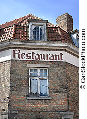 Restaurant - The word Restaurant at facade of building in...