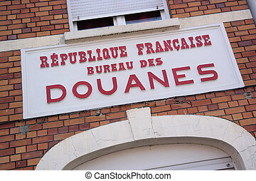 French border - Douanes sign, a former customs building on...