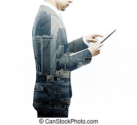 businessman holding tablet, double exposure