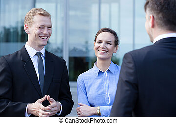 Business people during small talk - Group of business people...