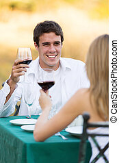 young man having dinner with his girlfriend
