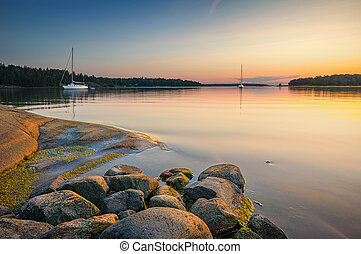 Tranquil scene with sailboats moored for the night, Sweden