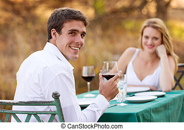 young man having romantic dinner with girlfriend