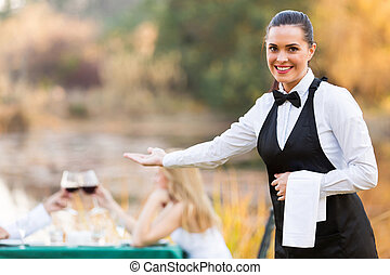 waitress welcomes customers - pretty young waitress welcomes...