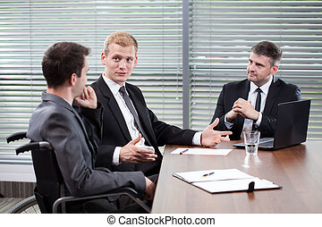 Disabled man during business meeting - Disabled man and his...