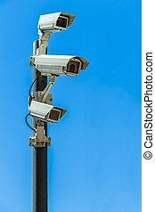 Security cameras on pole - Three surveillance cameras...